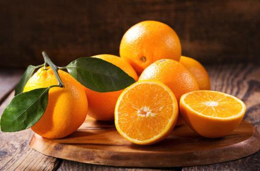 amazon fresh oranges on a table